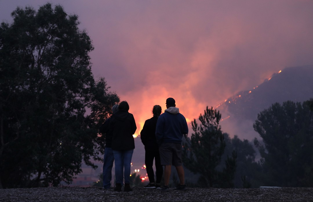 People watch the Blue Ridge fire burn on Foxtail Drive in Yorba Linda on Oct. 26, 2020. (Myung J. Chun/Los Angeles Times)