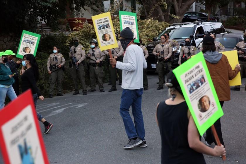 Protesters are seen outside L.A. County Sheriff Alex Villanueva's La Habra Heights home on Nov. 18, 2020. (Dania Maxwell / Los Angeles Times)