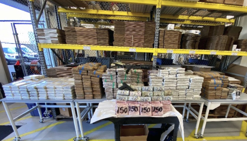 Federal agents seized $3.5 million in cash and massive quantities of cocaine, fentanyl and .50-caliber ammunition from an Otay Mesa truck yard. (Homeland Security Investigations)