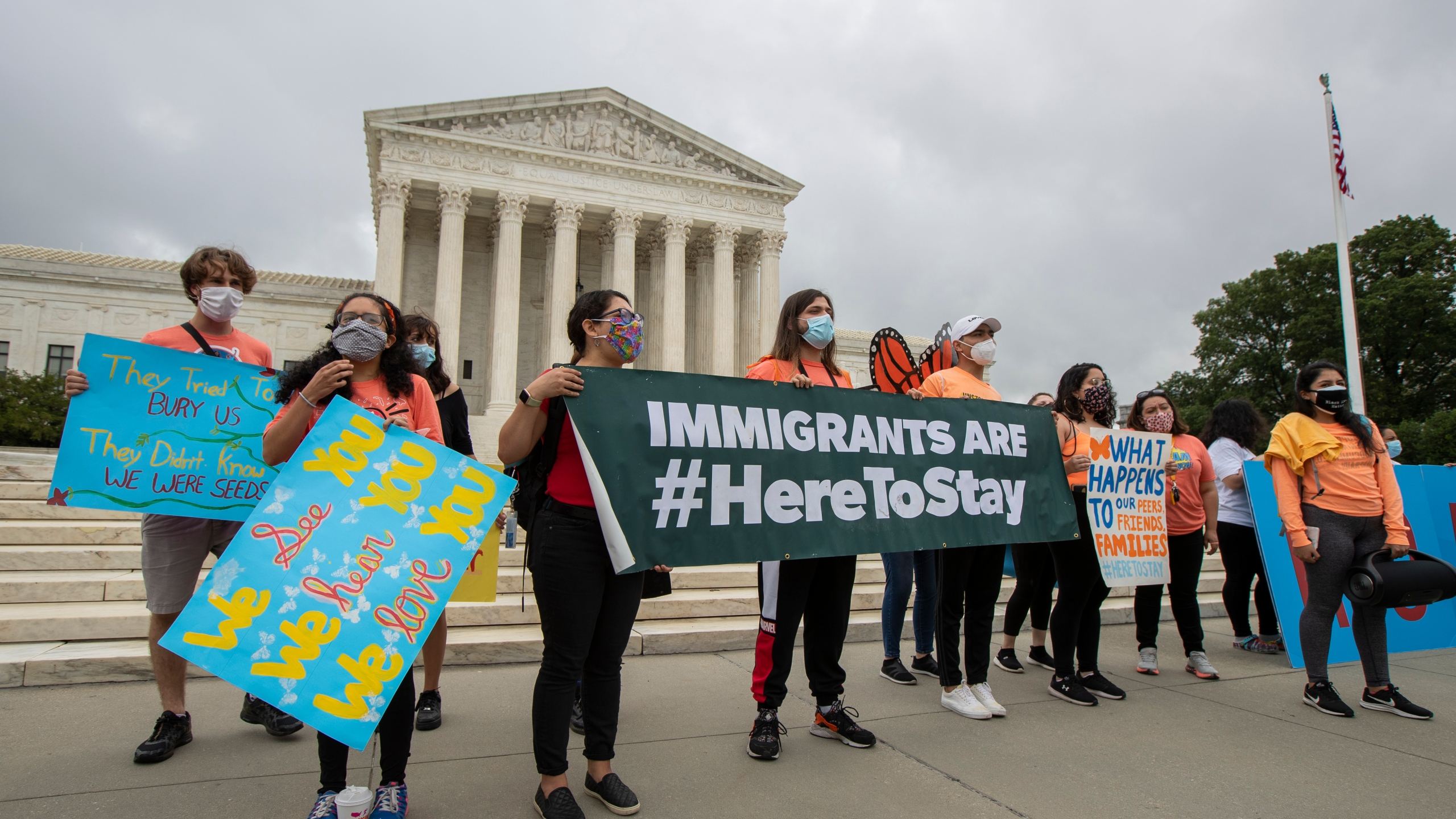 In this June 18, 2020, photo, Deferred Action for Childhood Arrivals (DACA) students celebrate in front of the Supreme Court after the Supreme Court rejected President Donald Trump's effort to end legal protections for young immigrants. (Manuel Balce Ceneta / Associated Press)