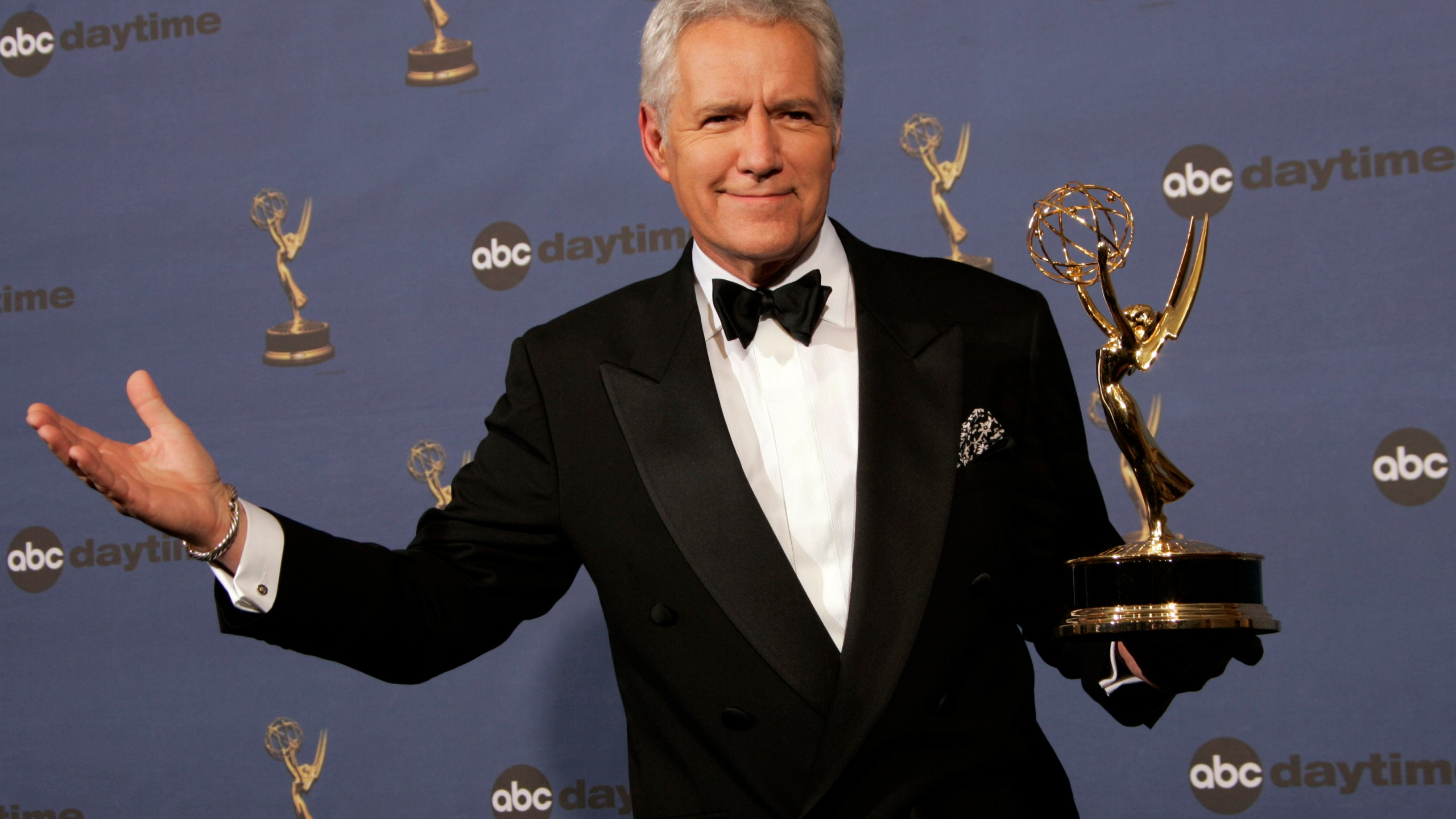 """In this Friday, April 28, 2006, file photo, Alex Trebek holds the award for outstanding game show host, for his work on """"Jeopardy!"""" backstage at the 33rd Annual Daytime Emmy Awards in Los Angeles. Sony Television spokeswoman Paula Askanas said Sunday, June 24, 2012, that Trebek is in a Los Angeles hospital recovering from a mild heart attack. (AP Photo/Reed Saxon, File)"""