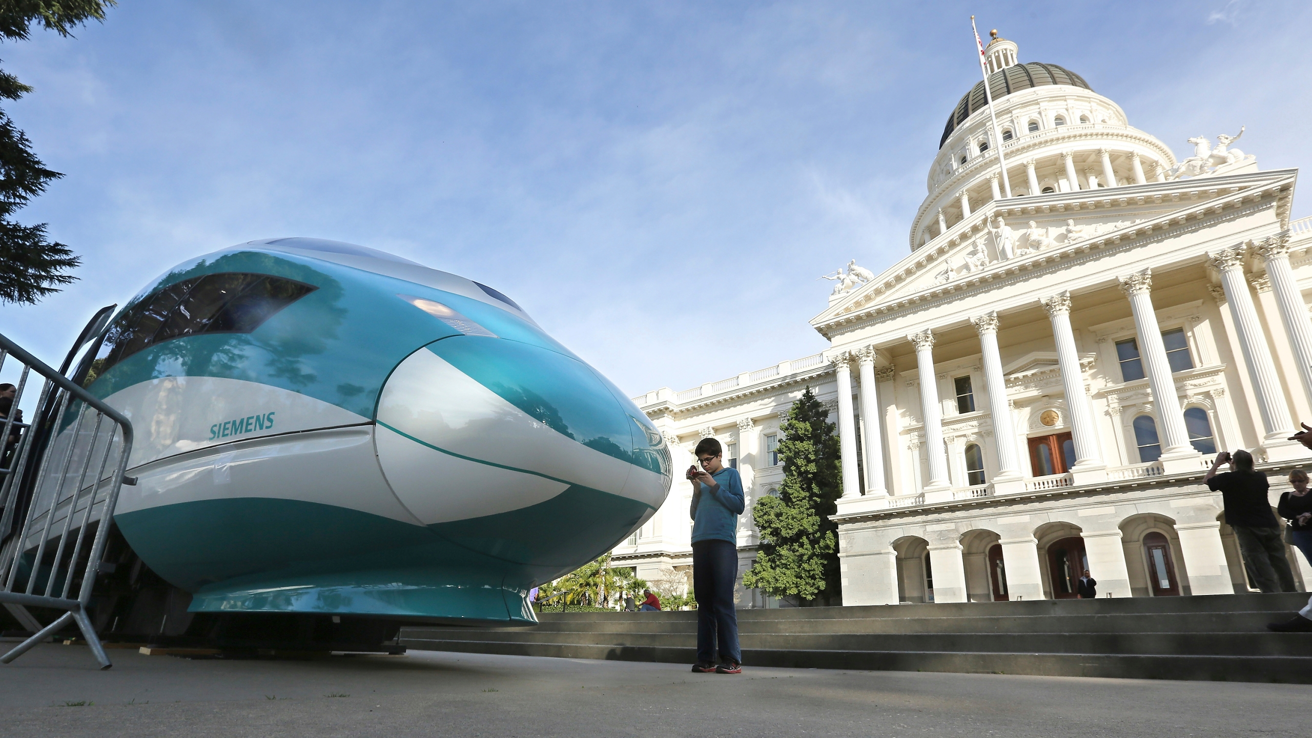 In this Feb. 26, 2015, file photo, a full-scale mock-up of a high-speed train is displayed at the Capitol in Sacramento. (AP Photo/Rich Pedroncelli, file)