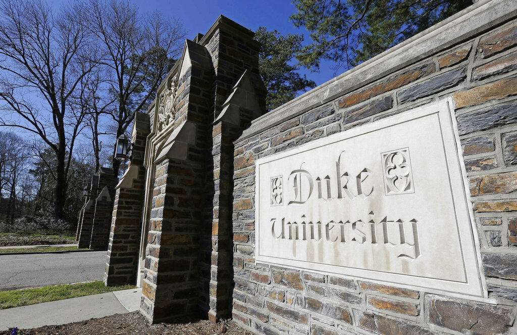 This Jan. 28, 2019 file photo shows the entrance to the main Duke University campus in Durham, N.C. (AP Photo/Gerry Broome, File)