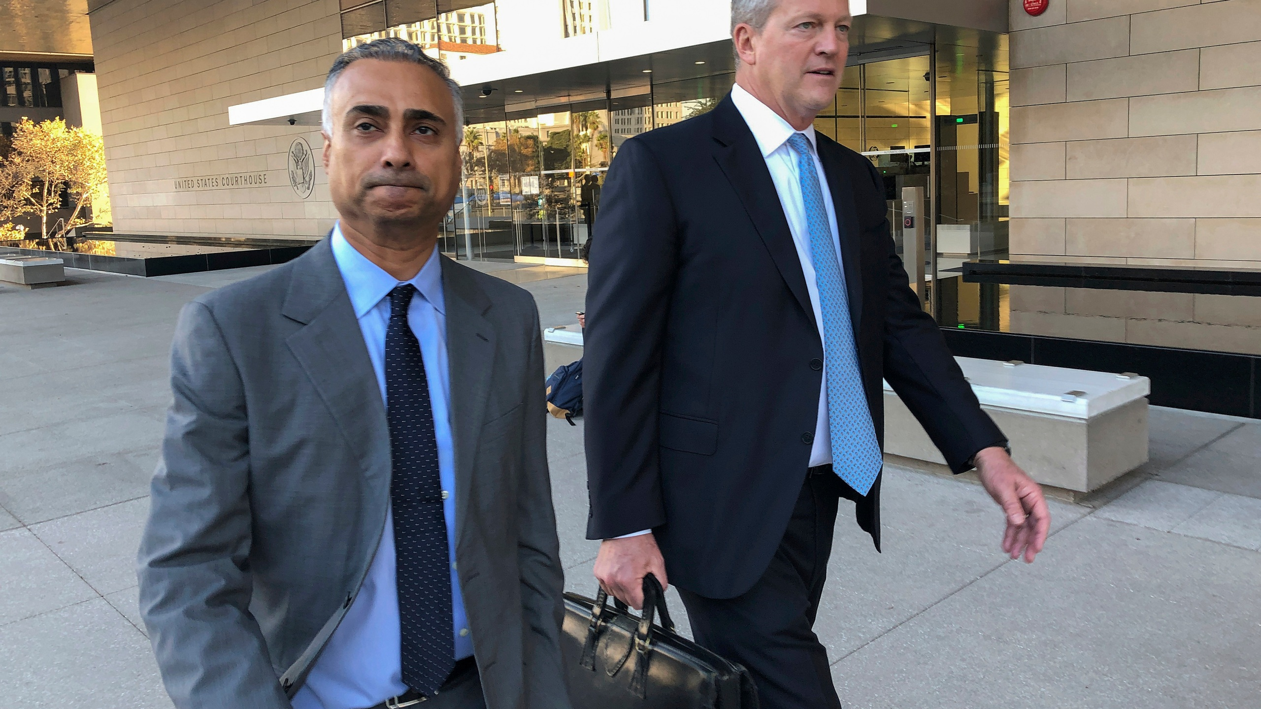 Imaad Zuberi, left, leaves the federal courthouse in Los Angeles with his attorney Thomas O'Brien, right, on Nov. 22, 2019. (Brian Melley / Associated Press)