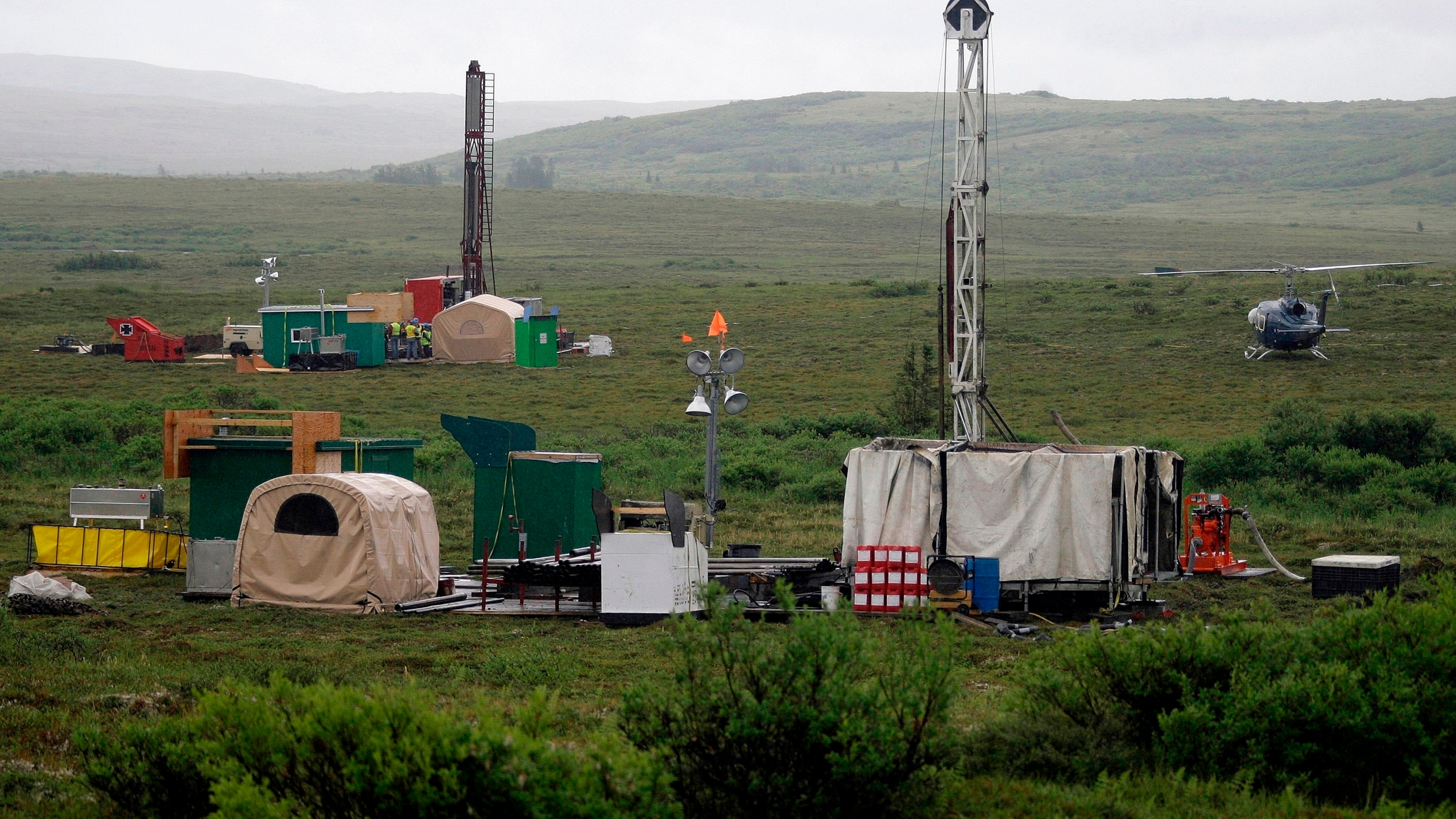 In this July 13, 2007, file photo, workers with the Pebble Mine project test drill in the Bristol Bay region of Alaska, near the village of Iliamma. (AP Photo/Al Grillo, File)