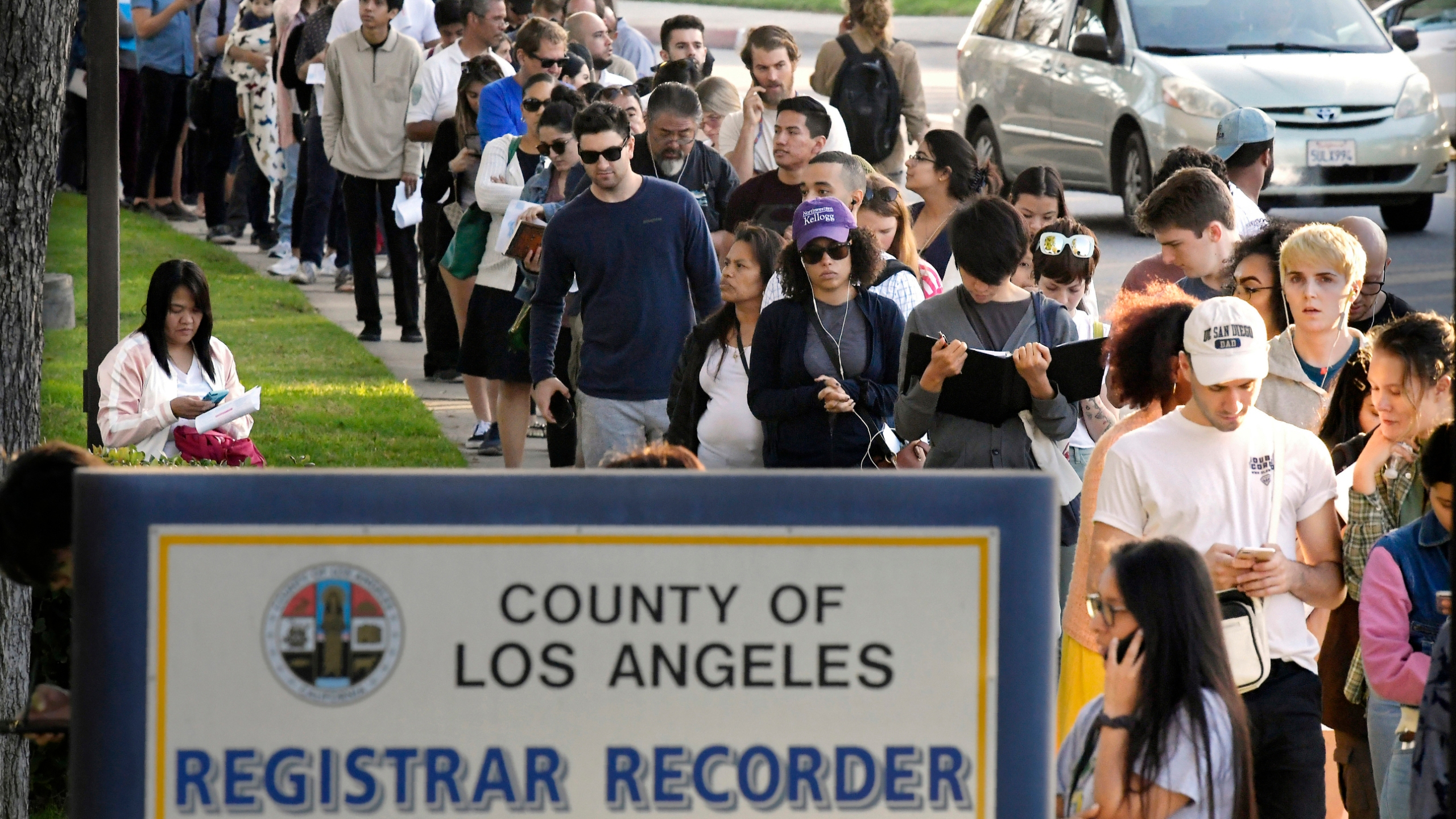 In this Nov. 6, 2018, file photo, potential voters wait in long lines to register and vote at the Los Angeles County Registrar's office in Norwalk. (Mark J. Terrill / Associated Press)