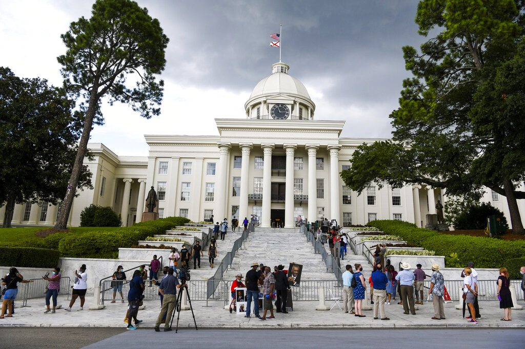 In this July 26, 2020, file photo, mourners gathered at the Alabama Capitol following the death of Rep. John Lewis. (AP Photo/Julie Bennett, File)