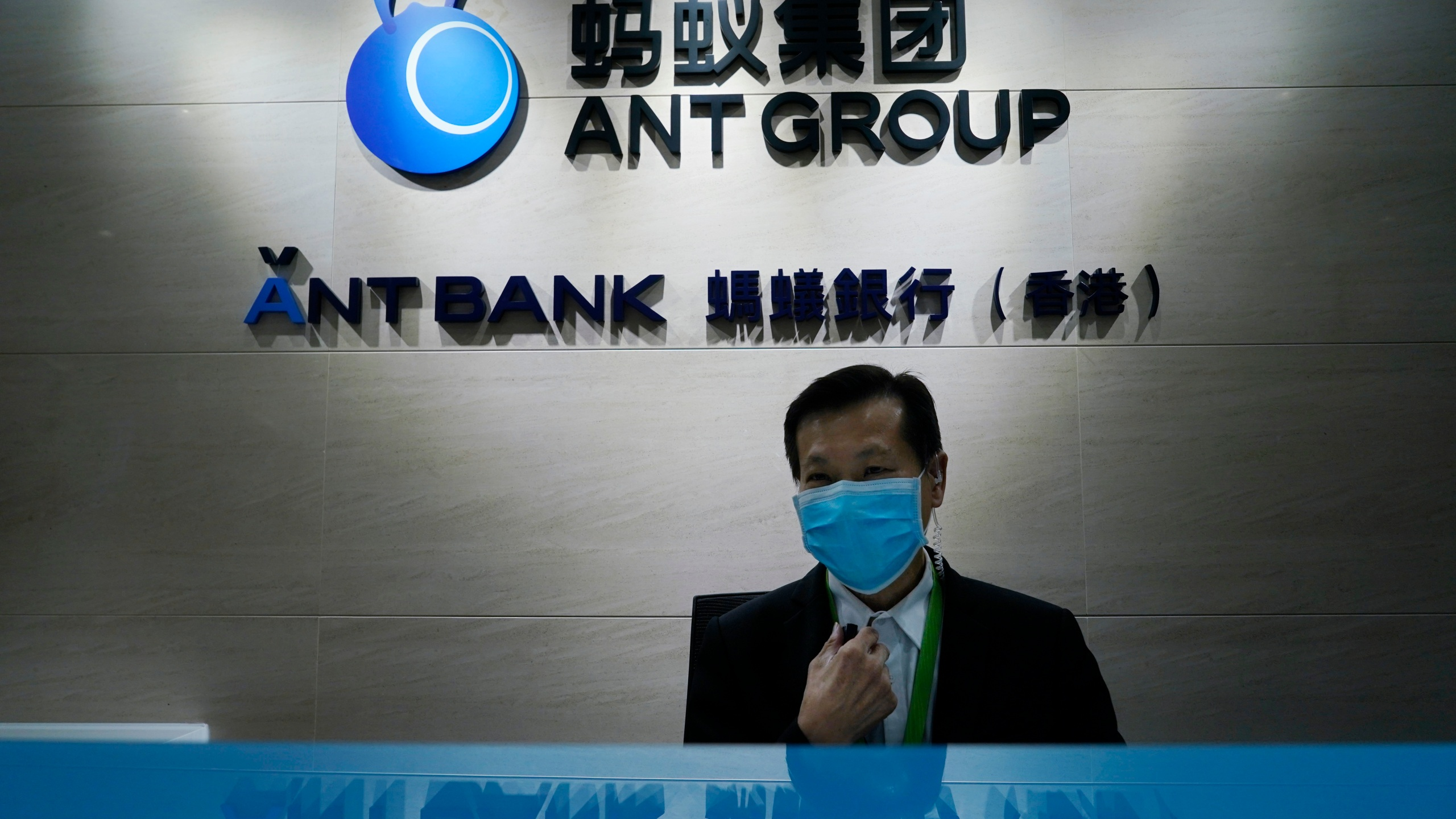 In this Friday, Oct. 23, 2020, photo, an employee sits at the Ant Group office in Hong Kong. (Kin Cheung/AP Photo)