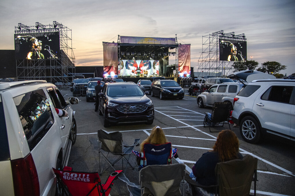Attendees sit next to their car as J.R. Moore & Zack Mack perform at the Drive-In at Westland Mall in Columbus, Ohio on Oct. 10, 2020. (Amy Harris/Invision/AP, File)