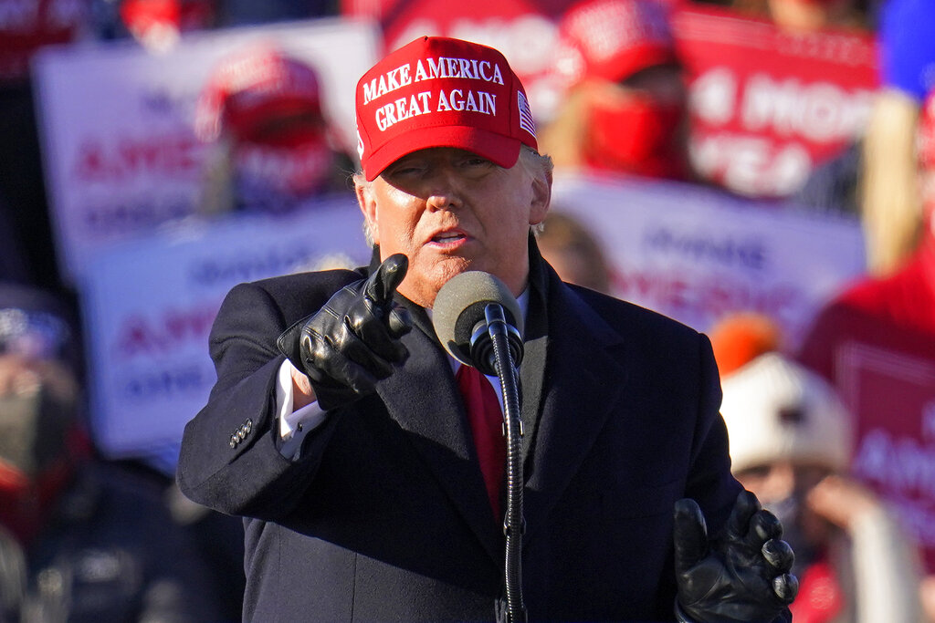 President Donald Trump gestures while addressing a campaign rally at the Wilkes-Barre Scranton International Airport in Avoca, Pa on Nov. 2, 2020. (AP Photo/Gene J. Puskar)