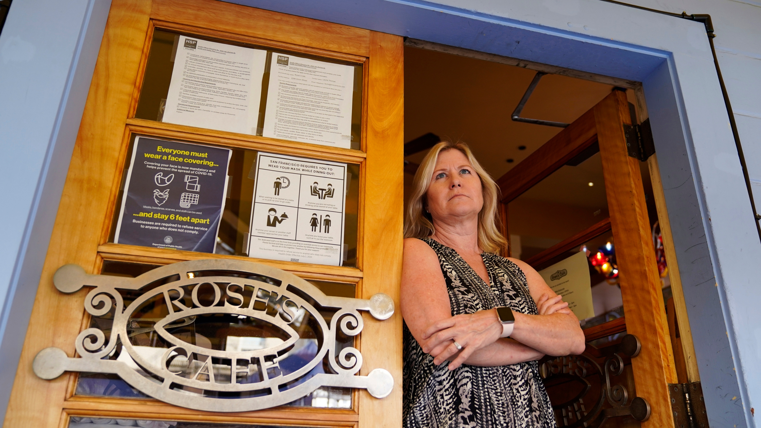 Laurie Thomas poses at the entrance to her Rose's Cafe restaurant in San Francisco on Sept. 28, 2020. (Eric Risberg / Associated Press)