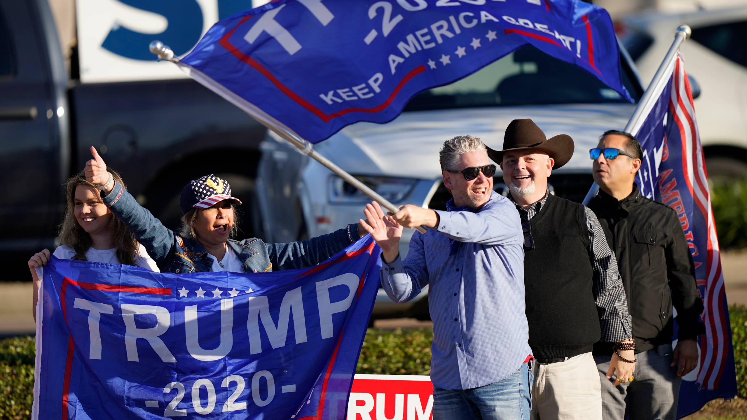 Supporters of President Trump cheer as passing cars honk their horns near a polling location in Houston on Election Day, Nov. 3, 2020. (David J. Phillip / Associated Press)