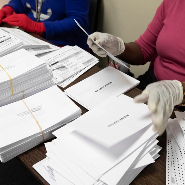 Workers prepare paper absentee ballots to be counted at the Richland County Administration Building on Nov. 3, 2020. (Tracy Glantz/The State via AP)