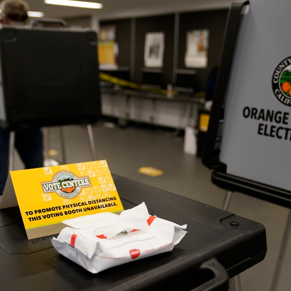 A sign designates physical distancing at a polling place in Newport Beach on Nov. 3, 2020. (Ashley Landis / Associated Press)