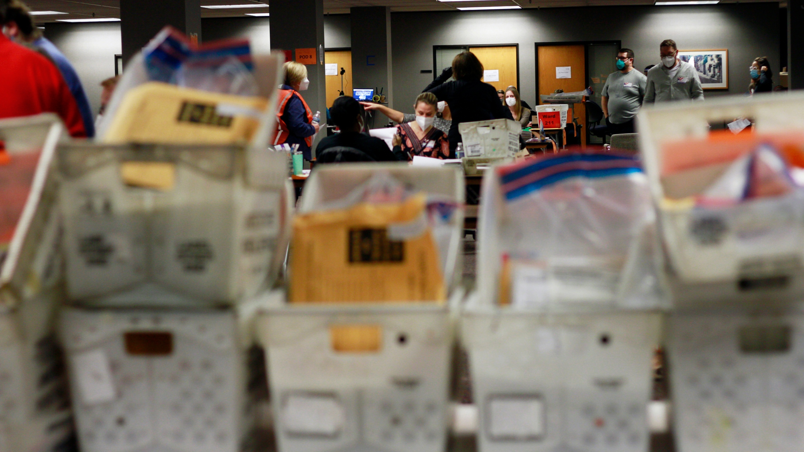 Election workers count absentee ballots into the early morning, Wednesday, Nov. 4, 2020 in Milwaukee at a central counting facility. (AP Photo/Stephen Groves)