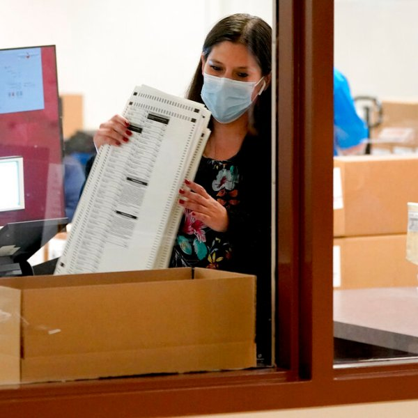 Maricopa County elections officials count ballots, Wednesday, Nov. 4, 2020, at the Maricopa County Recorders Office in Phoenix. (AP Photo/Matt York)