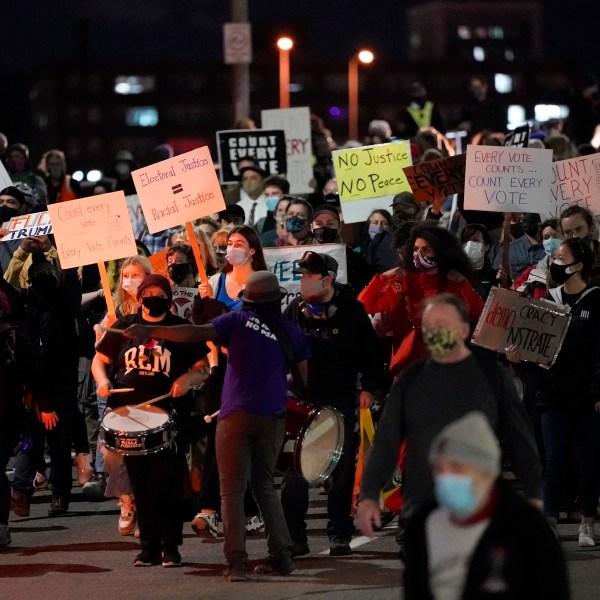 Protesters march in Portland, Ore., Wednesday, Nov. 4, 2020, following Tuesday's election. (AP Photo/Marcio Jose Sanchez)