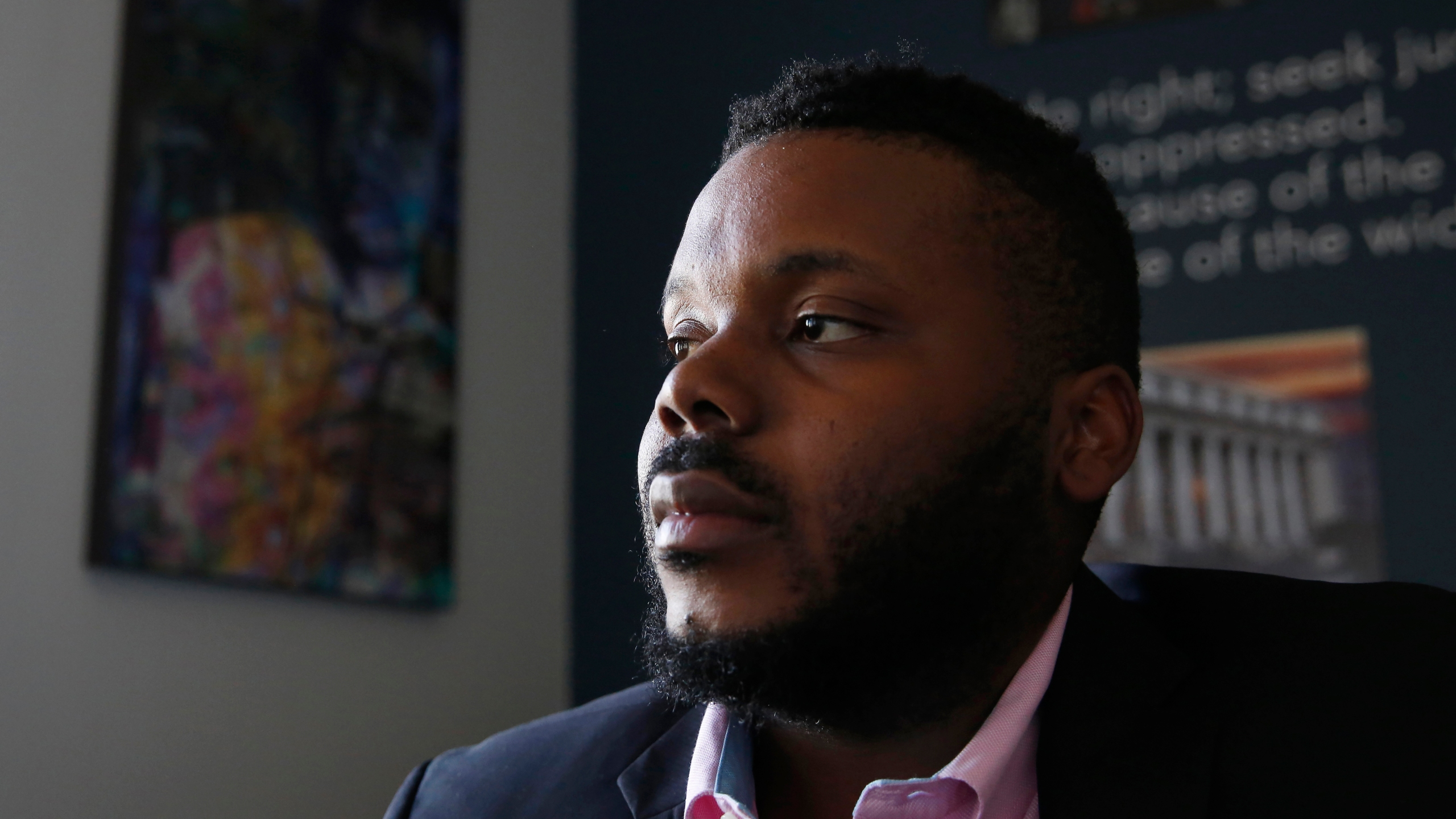 In this Aug. 14, 2019, file photo, Stockton Mayor Michael Tubbs talks during an interview in Stockton, Calif. Tubbs is one of the youngest mayors in the country and was the city's first Black mayor. He garnered national attention with his universal basic income program that fights poverty by paying people $500 a month. But despite winning 70% of the vote, Tubbs is trailing a Republican challenger, putting him in danger of losing his seat. (AP Photo/Rich Pedroncelli, File)