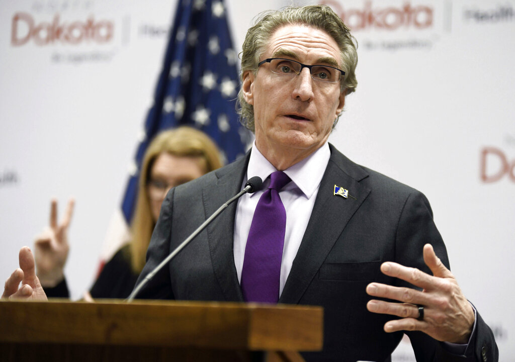 In this April 10, 2020, file photo, North Dakota Gov. Doug Burgum speaks at the state Capitol in Bismarck, N.D. North Dakota and South Dakota have the nation's worst rate of coronavirus deaths per capita in the last 30 days. Despite advances in treating coronavirus patients, hundreds more people in the Dakotas have died in recent weeks than during any other time of the pandemic. (Mike McCleary/The Bismarck Tribune via AP, File)