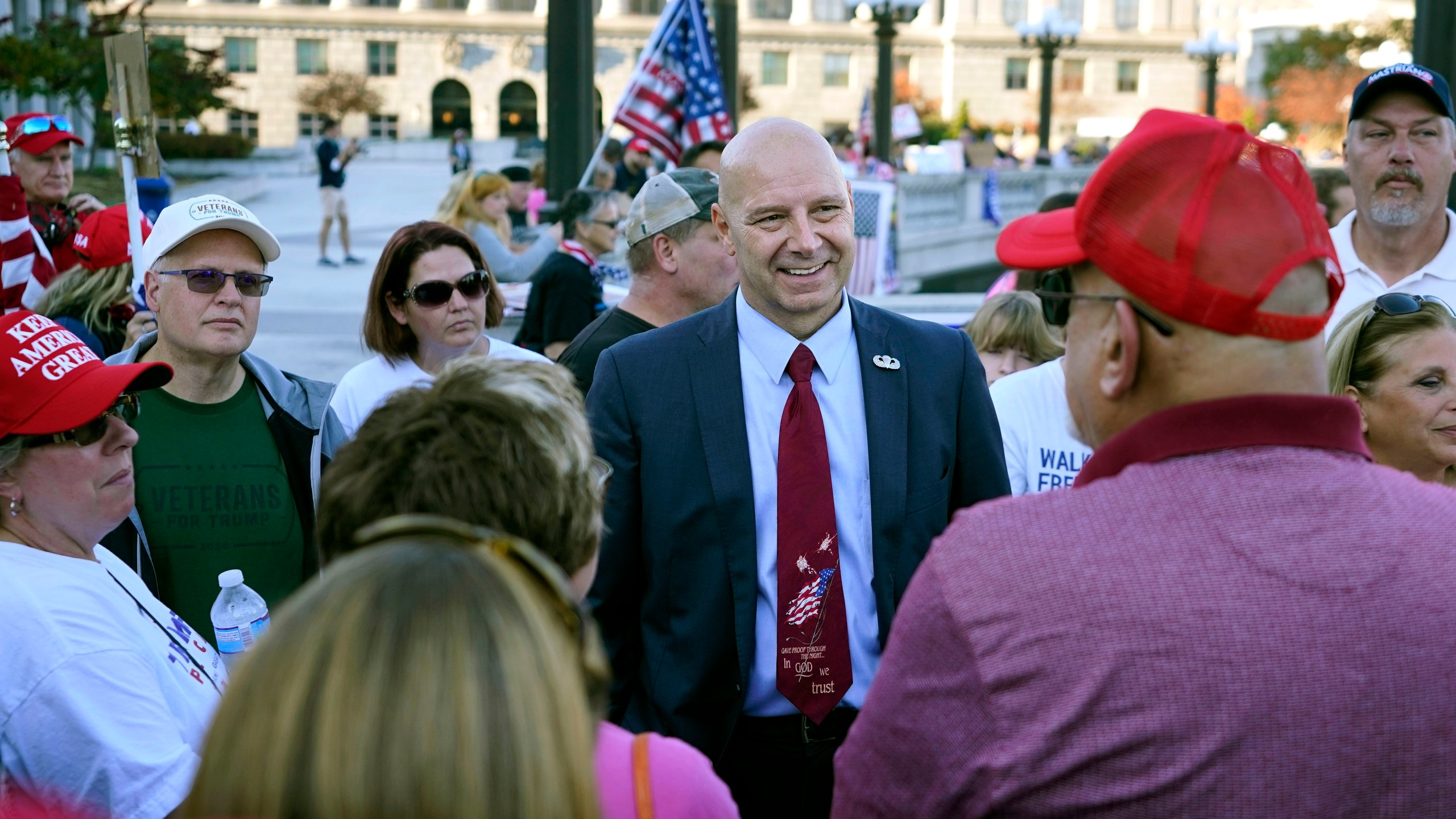 Pennsylvania state Sen. Doug Mastriano, R-Franklin, center, speaks to supporters of President Donald Trump as they demonstrate outside the Pennsylvania State Capitol, Saturday, Nov. 7, 2020, in Harrisburg, Pa., after Democrat Joe Biden defeated Trump to become 46th president of the United States. (Julio Cortez/AP Photo)