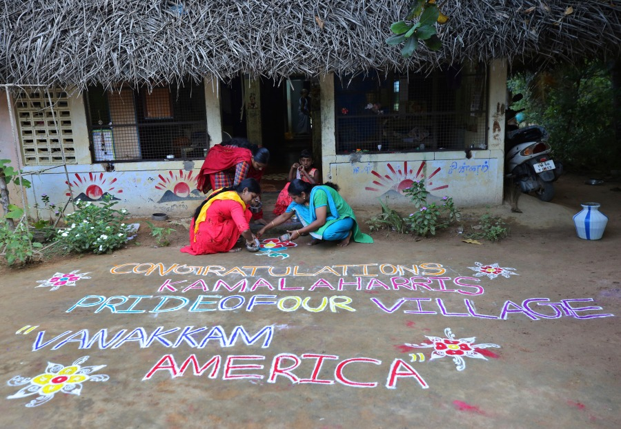 Indian women prepare a Kolam, a traditional art work using colored powder, congratulating U.S. Vice President-elect Kamala Harris in the hometown of Harris' maternal grandfather, in Thulasendrapuram, south of Chennai, Tamil Nadu state, India, Sunday, Nov. 8, 2020. (AP Photo/Aijaz Rahi)