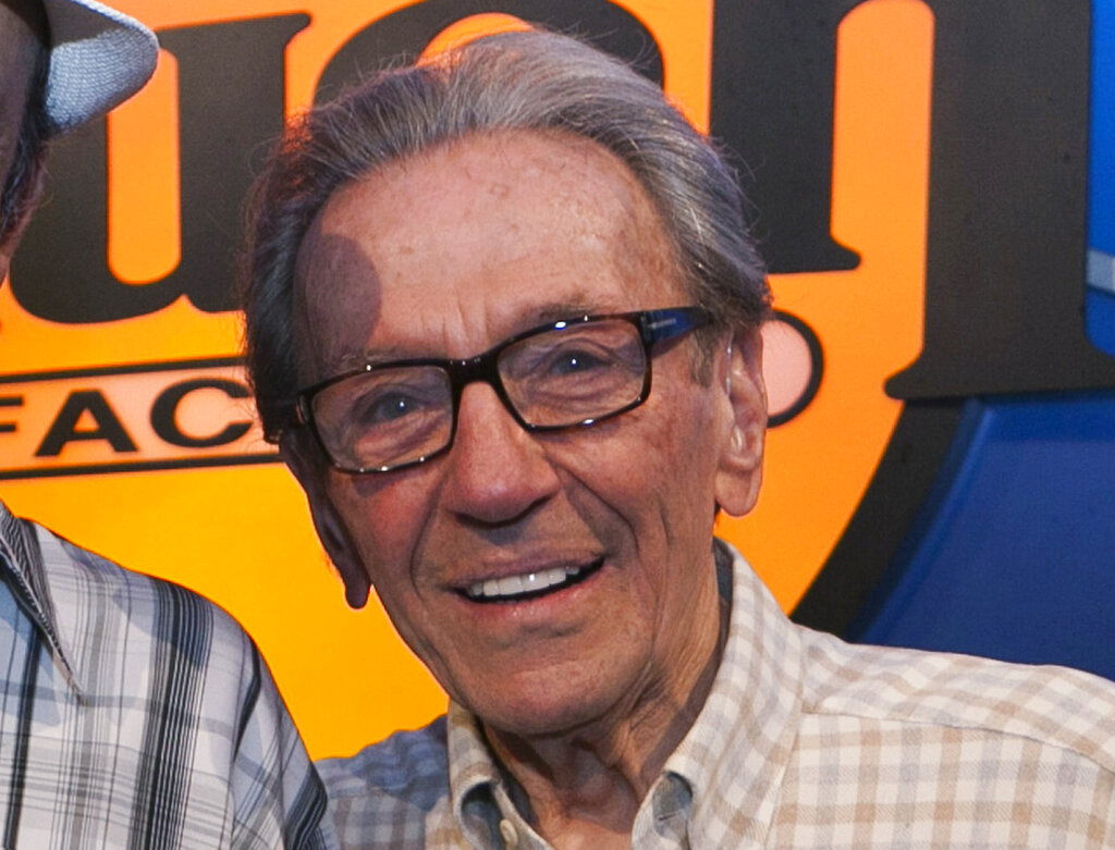 In this Aug. 5, 2011, file photo, Norm Crosby poses for a photo while expressing support for Jerry Lewis to be reinstated as host of the annual MDA Telethon, at the Laugh Factory in Los Angeles. (AP Photo/Damian Dovarganes, File)