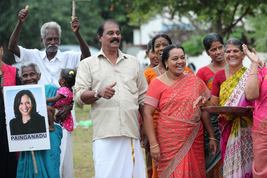 Villagers celebrate the victory of U.S. Vice President-elect Kamala Harris in Painganadu a neighboring village of Thulasendrapuram, the hometown of Harris' maternal grandfather, south of Chennai, Tamil Nadu state, India, Sunday, Nov. 8, 2020. Waking up to the news of Kamala Harris' election as Joe Biden's running mate, overjoyed people in her Indian grandfather's hometown are setting off firecrackers, carrying her placards and offering prayers. (AP Photo/Aijaz Rahi)