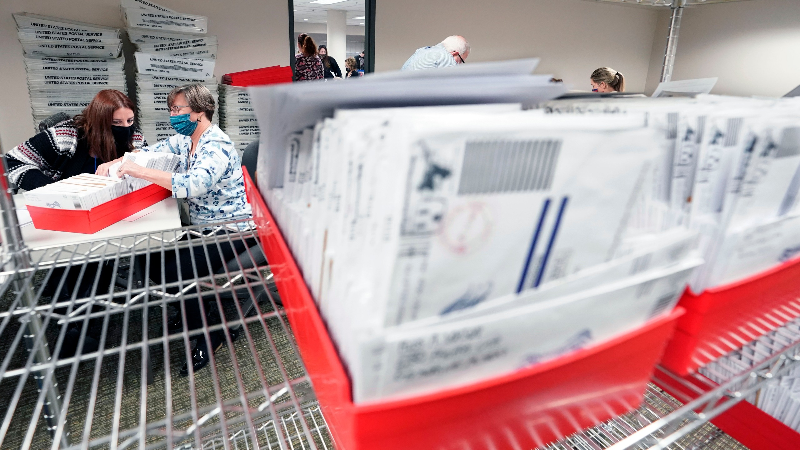 In this Nov. 5, 2020, photo, Lehigh County workers count ballots as vote counting in the general election continues in Allentown, Pa. (AP Photo/Mary Altaffer)