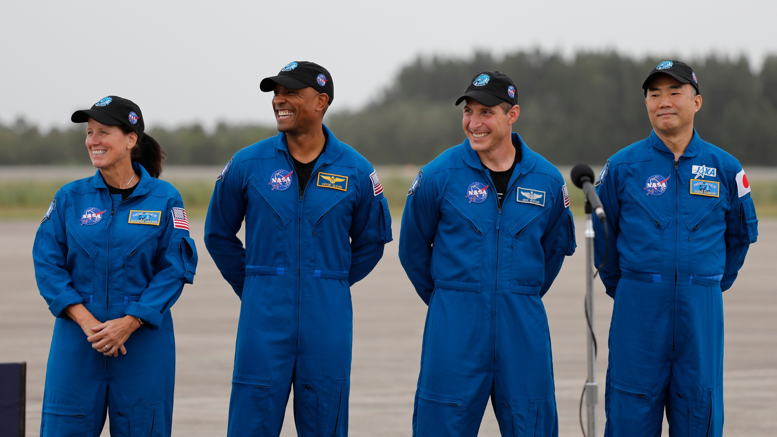 NASA Astronauts from left Shannon Walker, Victor Glover, Michael Hopkins and Japan Aerospace Exploration Agency Astronaut Soichi Noguchi smile during a news conference after they arrived at the Kennedy Space Center, Sunday, Nov. 8, 2020, in Cape Canaveral, Fla. (AP Photo/Terry Renna)