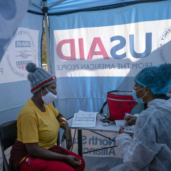 In this July 2, 2020 file photo, nurse Nomautanda Siduna, right, talks to a patient who is HIV-positive inside a gazebo used as a mobile clinic in Ngodwana, South Africa. Researchers are stopping a study early after finding that a shot of an experimental medicine every two months worked better than daily Truvada pills to help keep uninfected women from catching HIV from an infected sex partner. The news is a boon for AIDS prevention efforts especially in Africa, where the study took place, and where women have few discreet ways of protecting themselves from infection. (AP Photo/Bram Janssen, File)