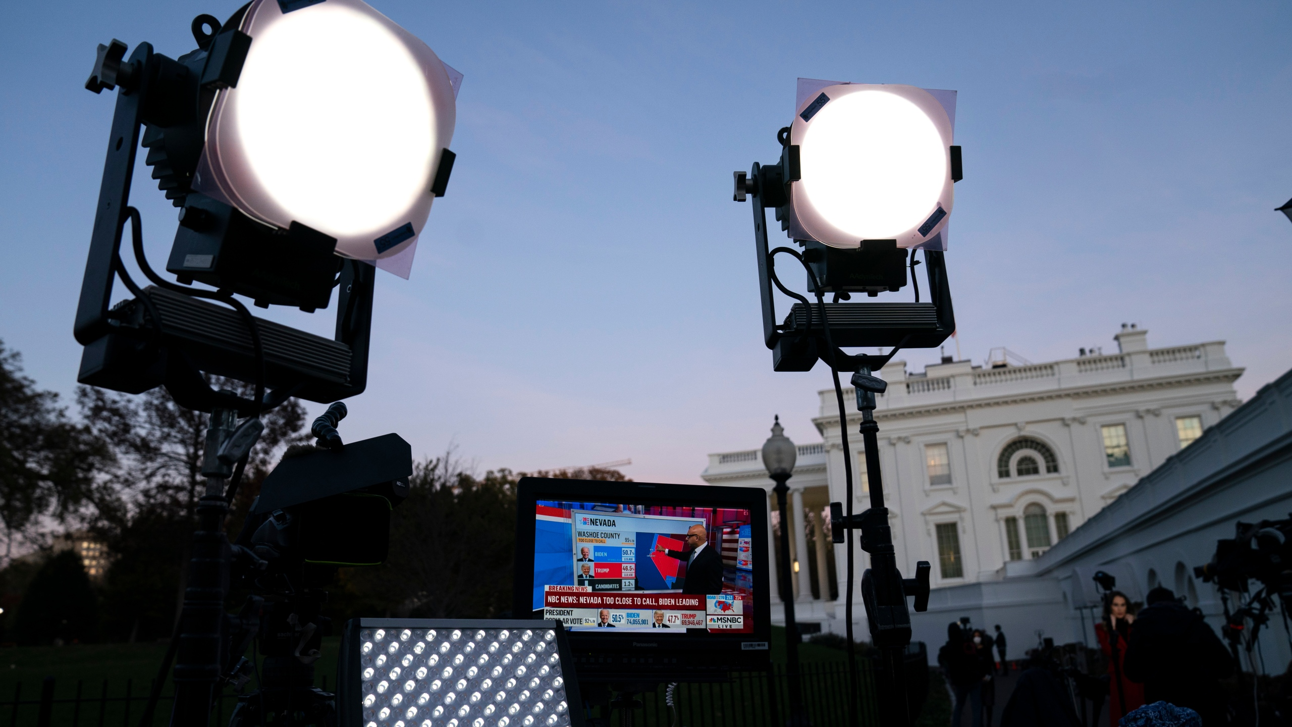In this Nov. 6, 2020, file photo, media organizations set up outside the White House in Washington. (AP Photo/Evan Vucci, File)