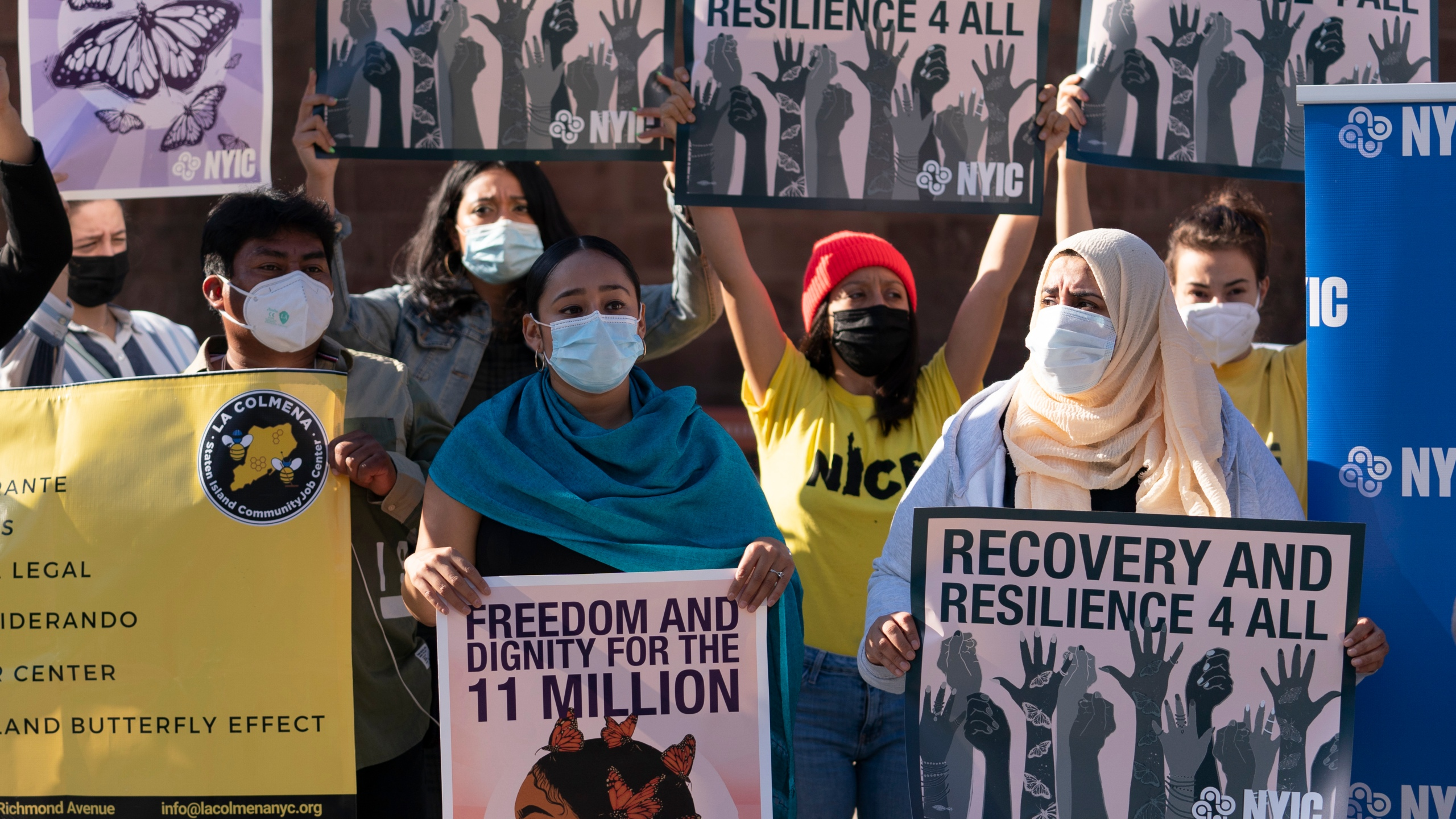 Demonstrators with the New York Immigration Coalition rally asking President-elect Joe Biden to prioritize immigration reform, Monday, Nov. 9, 2020, in New York. (AP Photo/Mark Lennihan)