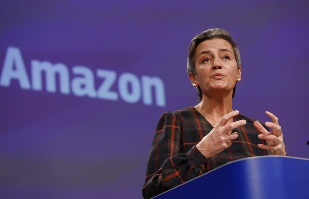 European Executive Vice-President Margrethe Vestager speaks during a press conference regarding an antitrust case with Amazon at EU headquarters in Brussels, Tuesday, Nov. 10, 2020. (Olivier Hoslet, Pool via AP)