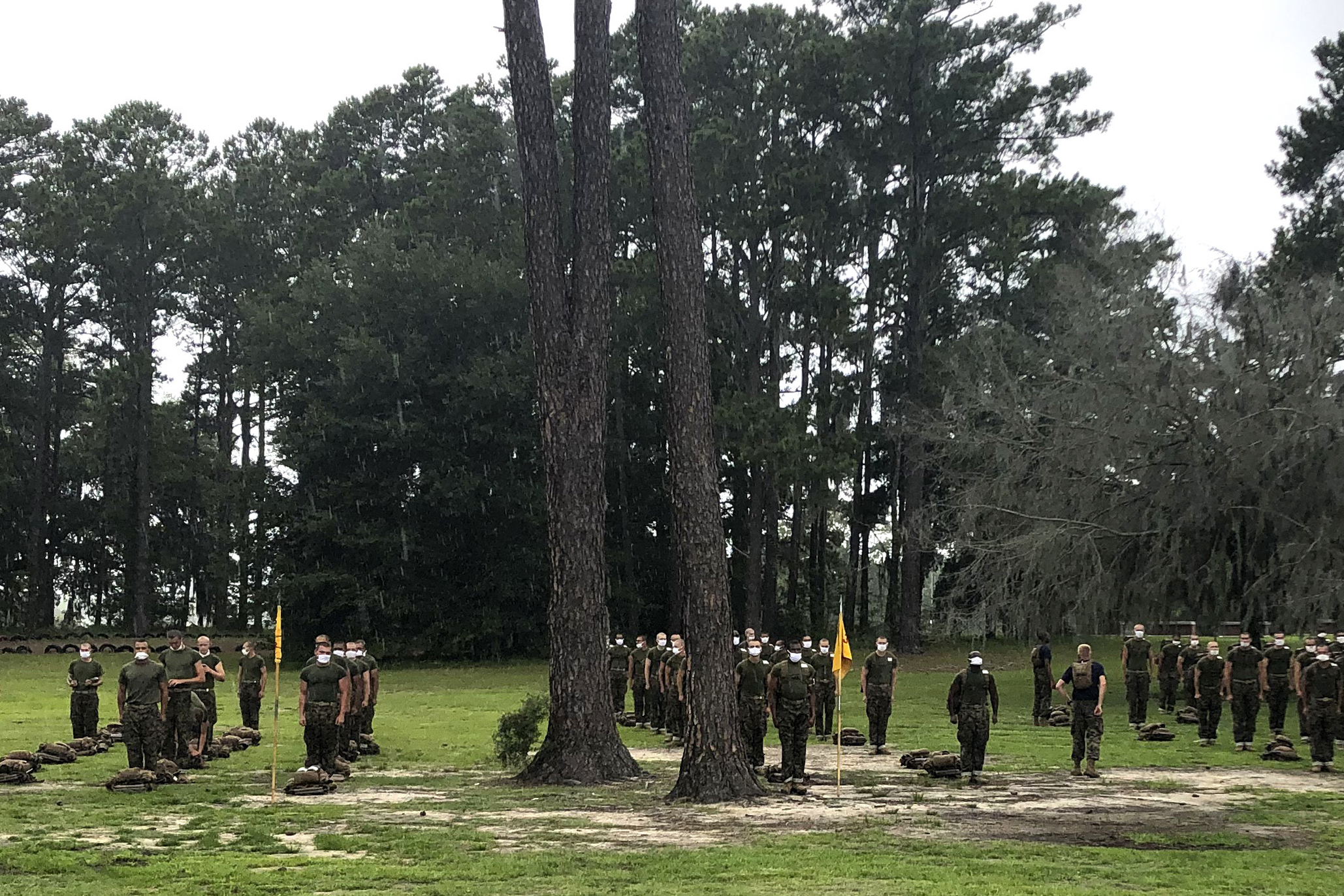 In this May 27, 2020, photo, Marine recruits line up at Parris Island Recruit Depot, S.C. A study published on Nov. 11, 2020, found that despite temperature and COVID-19 symptom checks and strict quarantines before they were allowed to start training, new Marine recruits spread the virus to others even though hardly any of them had symptoms. None of the infections that occurred were caught through symptom screening. (Lolita Baldor / Associated Press)