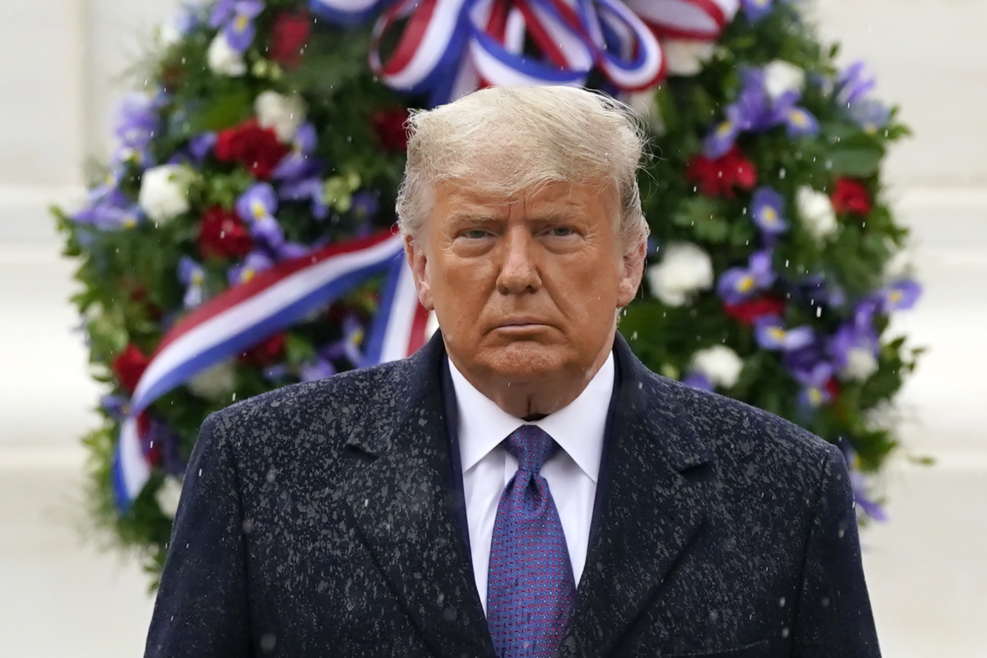 Donald Trump participates in a Veterans Day wreath laying ceremony at the Tomb of the Unknown Soldier at Arlington National Cemetery in Arlington, Va., Wednesday, Nov. 11, 2020. (AP Photo/Patrick Semansky)