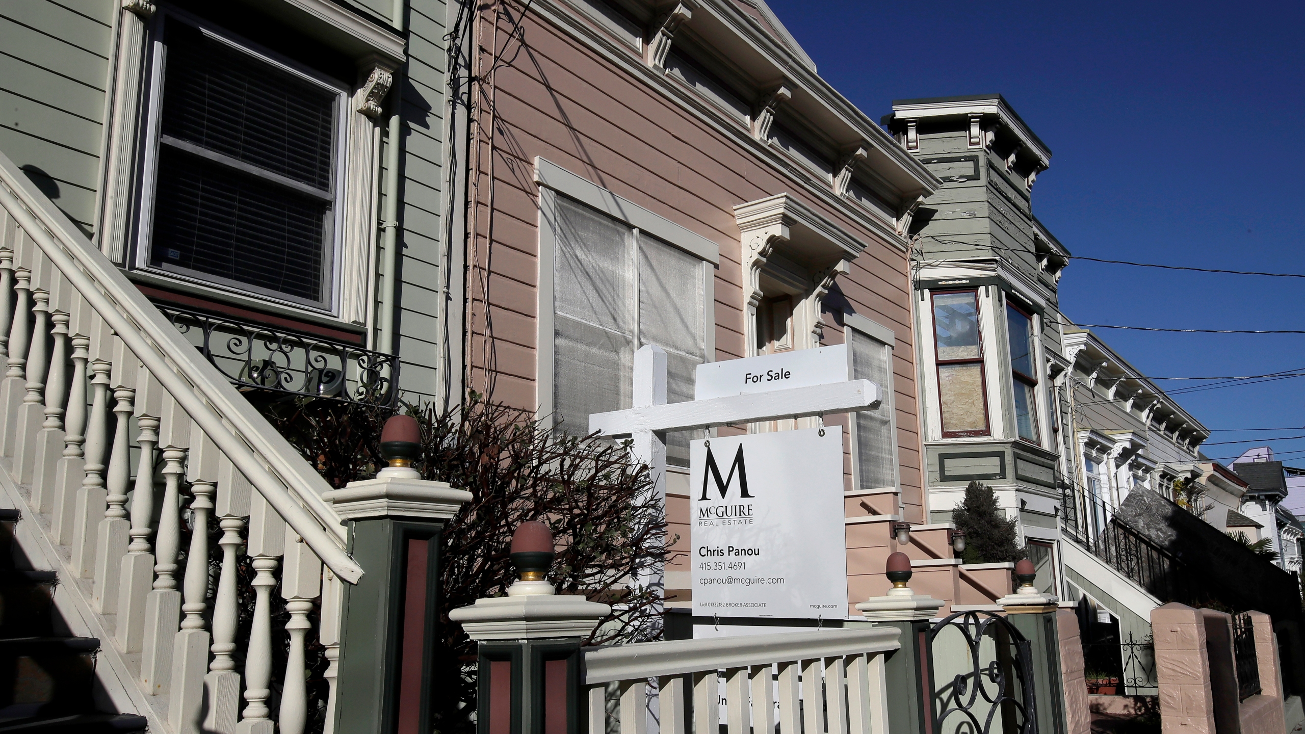 In this Feb. 18, 2020, file photo a real estate sign is shown in front of a home for sale in San Francisco. (AP Photo/Jeff Chiu, File)