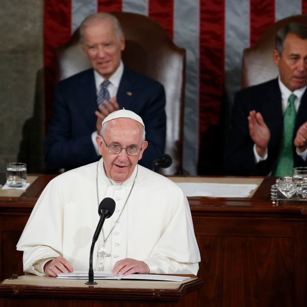 In this Sept. 24, 2015, file photo, Pope Francis addresses a joint meeting of Congress on Capitol Hill, making history as the first pontiff to do so. Listening behind the pope are Vice President Joe Biden and House Speaker John Boehner of Ohio. (Carolyn Kaster / Associated Press)