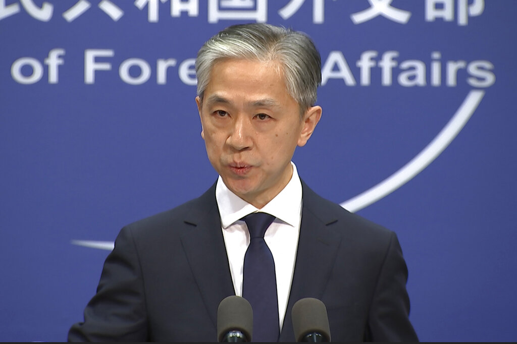 Chinese foreign ministry spokesman, Wang Wenbin, speaks during a routine press conference where he congratulated U.S. president-elect Joe Biden at the foreign ministry in Beijing on Friday, Nov. 13, 2020. (AP Photo/Liu Zheng)