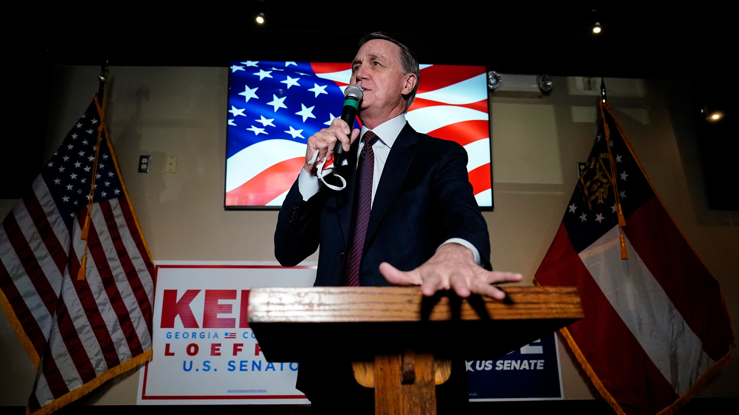 Republican candidate for U.S. Senate Sen. David Perdue speaks during a campaign rally on Friday, Nov. 13, 2020, in Cumming, Ga. Perdue and Democratic candidate Jon Ossoff are in a runoff election for the Senate seat in Georgia. (AP Photo/Brynn Anderson)