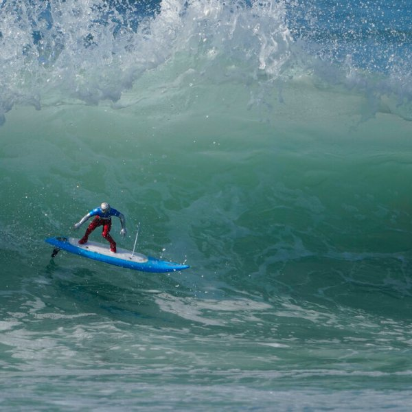 A remote-controlled RC surfer model rides a wave in Huntington Beach, Calif., Sunday, Nov. 15, 2020. ected to reach nearly 7 feet (2.13 meters). (AP Photo/Damian Dovarganes)