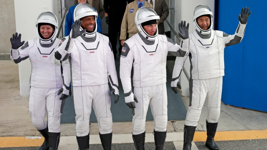 NASA astronauts, from left, Shannon Walker, Victor Glover, and Michael Hopkins and Japan Aerospace Exploration Agency astronaut Soichi Noguchi leave the Operations and Checkout Building on their way to launch pad 39A for the SpaceX Crew-1 mission to the International Space Station at the Kennedy Space Center in Cape Canaveral, Fla., on Nov. 15, 2020. (John Raoux / Associated Press)