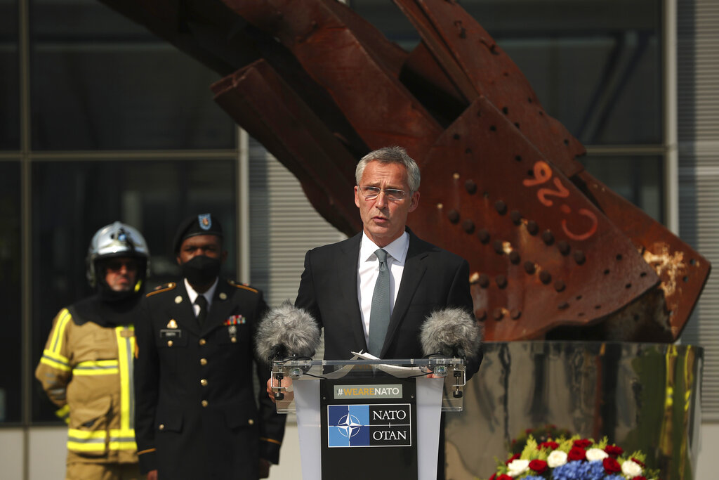 In this Friday, Sept. 11, 2020 file photo, NATO Secretary General Jens Stoltenberg speaks during a ceremony marking the 19th anniversary of the Sept. 11 attacks, at NATO headquarters in Brussels. (AP Photo/Francisco Seco, Pool, File)
