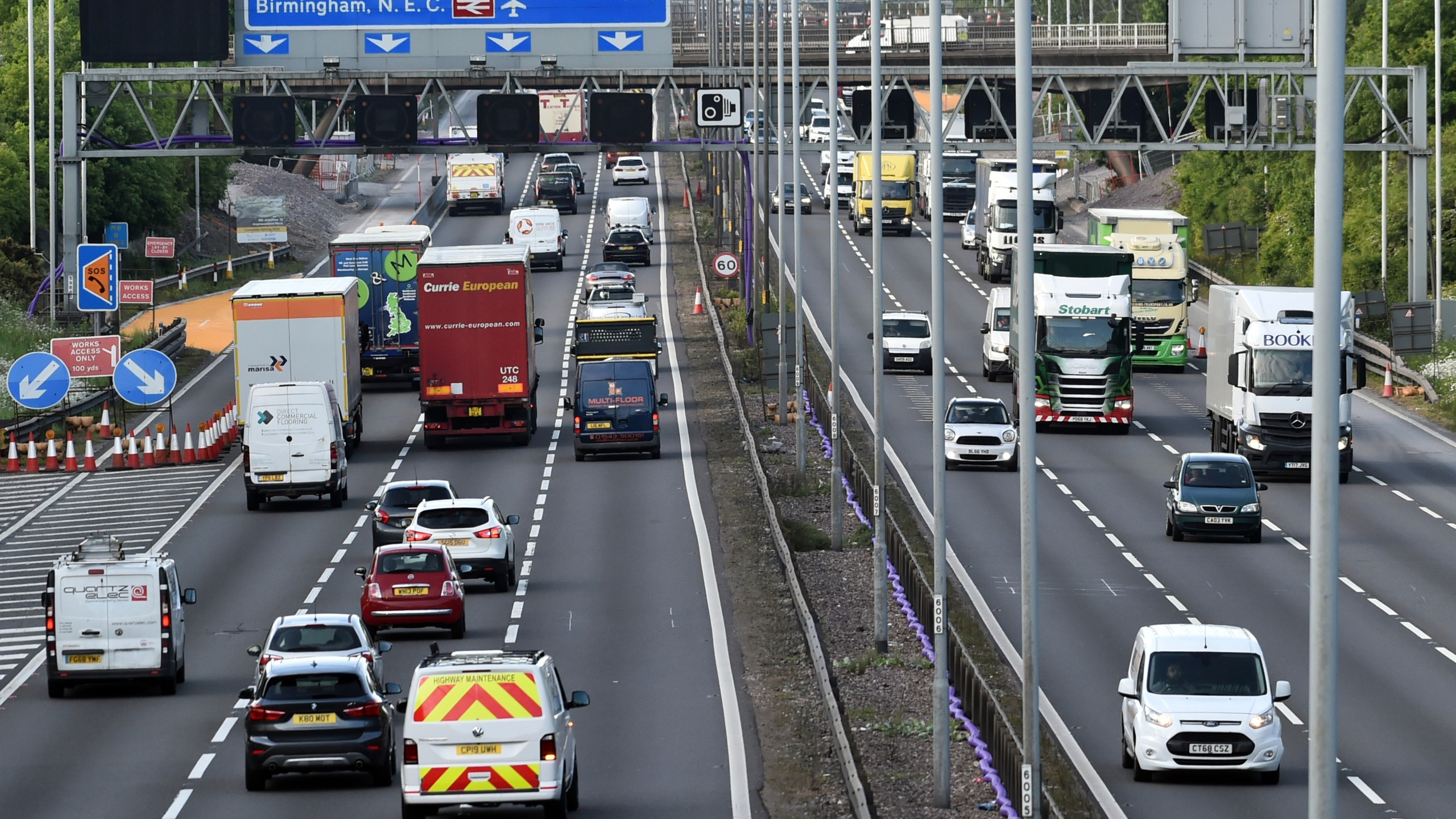 In this May 18, 2020, file photo, traffic moves along the M6 motorway near Birmingham, England. (AP Photo/Rui Vieira, File)