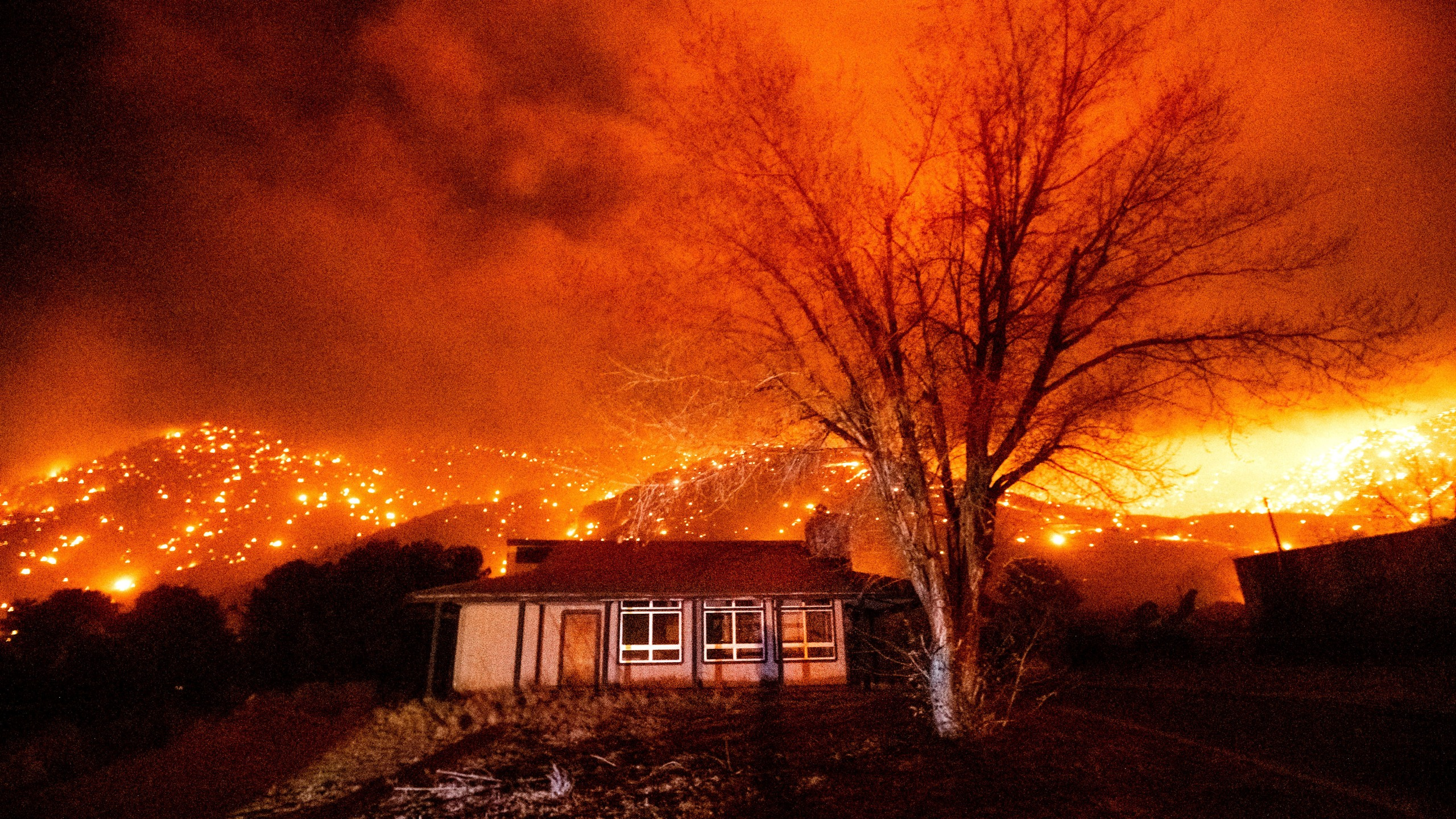 Embers burn along hillsides as the Mountain View Fire tears through the Walker community in Mono County, Calif., on Tuesday, Nov. 17, 2020. (AP Photo/Noah Berger)