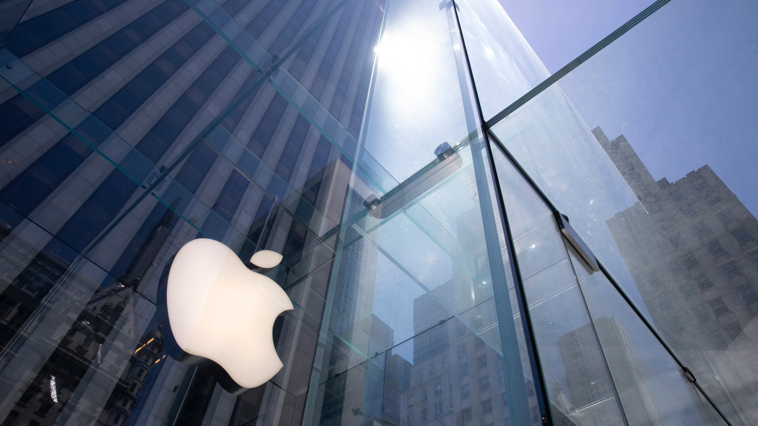In this June 16, 2020, file photo, the sun is reflected on Apple's Fifth Avenue store in New York. (Mark Lennihan/AP Photo)