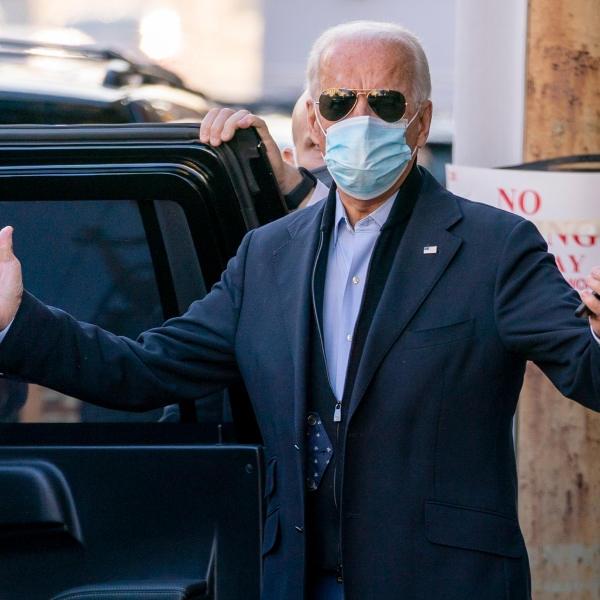 President-elect Joe Biden speaks to reporters as he leaves The Queen theater in Wilmington, Del. on Nov. 18, 2020. (Andrew Harnik/Associated Press)