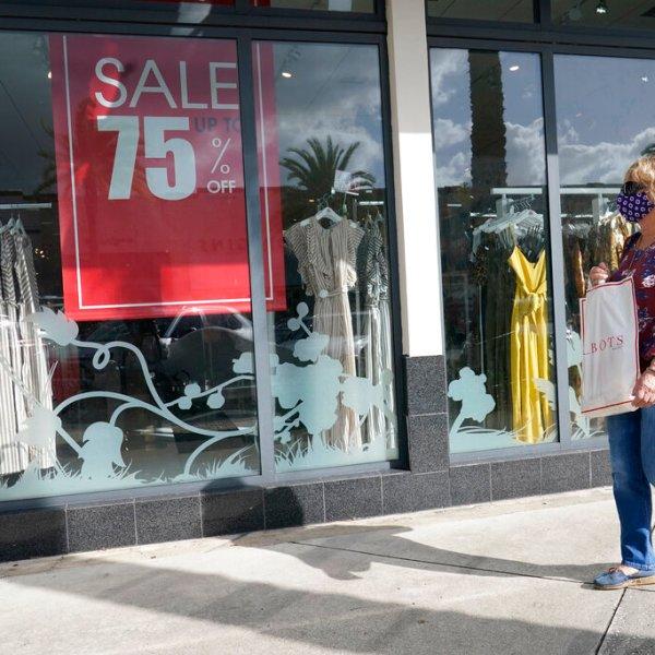 A shopper walks by a store, Monday, Nov. 18, 2020 in Pembroke Pines, Fla. (AP Photo/Marta Lavandier)
