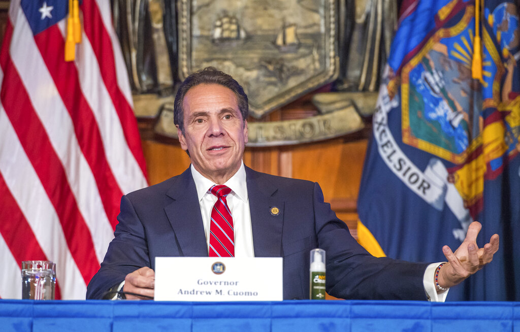 In this Wednesday, Nov. 18, 2020 photo provided by the Office of Governor Andrew M. Cuomo, Gov. Cuomo holds a press briefing on the coronavirus in the Red Room at the State Capitol in Albany, N.Y. (Darren McGee/Office of Governor Andrew M. Cuomo via AP)