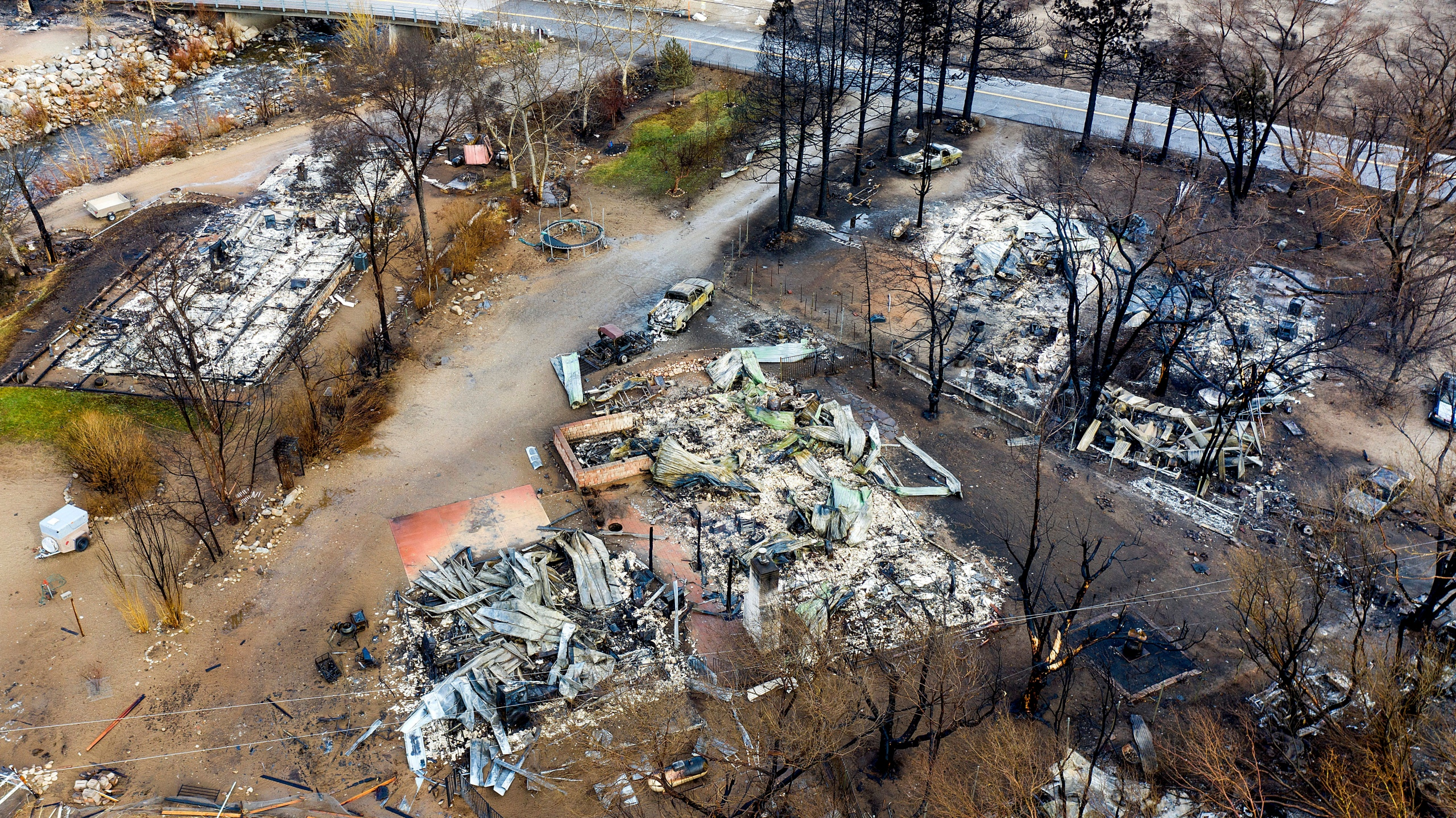 In this photo taken by a drone, homes destroyed by the Mountain View Fire line a street in the Walker community in Mono County, Calif., on Nov. 18, 2020. (Noah Berger / Associated Press)