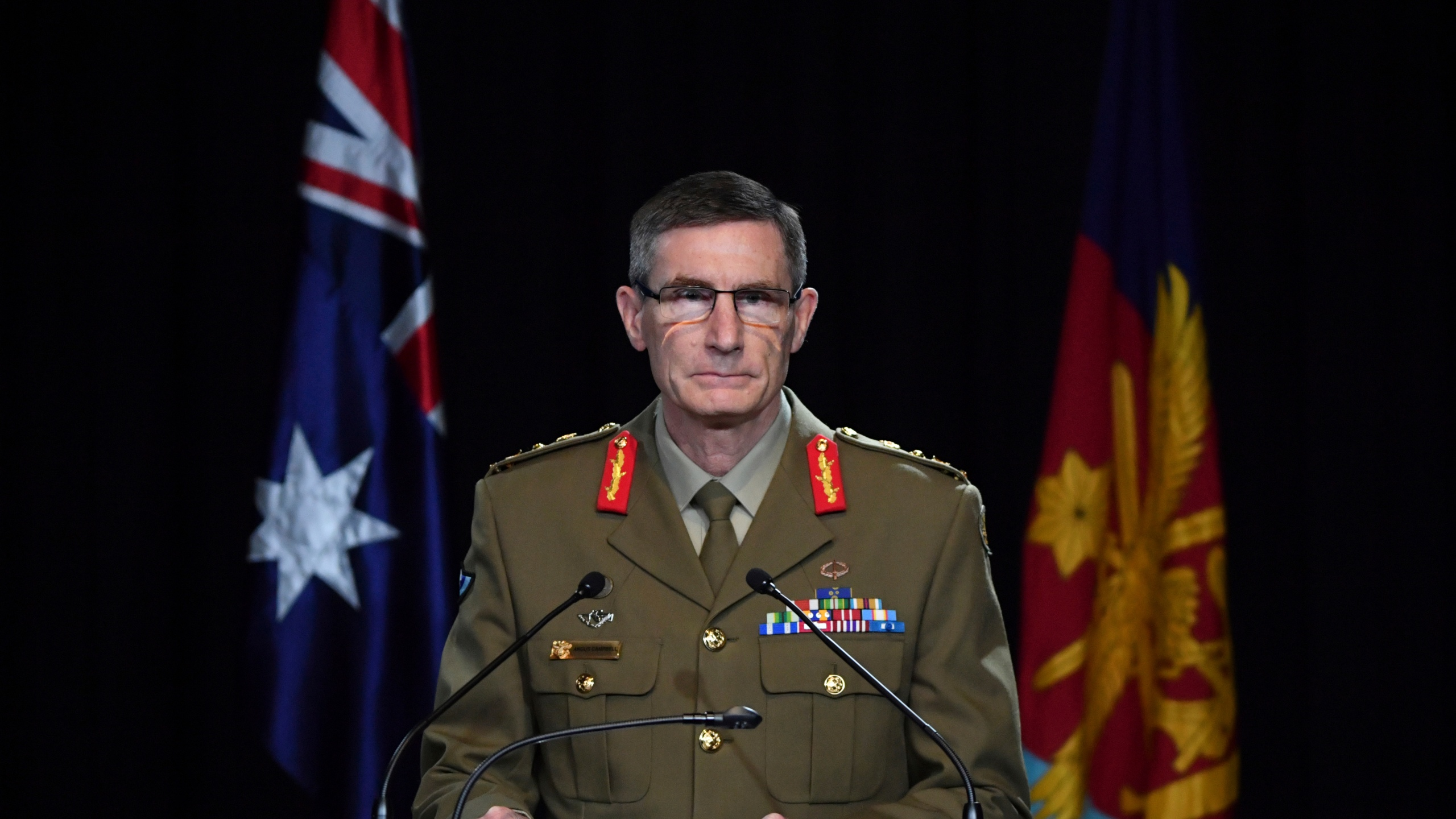 Chief of the Australian Defence Force Gen. Angus Campbell delivers the findings from the Inspector-General of the Australian Defence Force Afghanistan Inquiry, in Canberra, Thursday, Nov. 19, 2020. (Mick Tsikas/Pool Photo via AP)